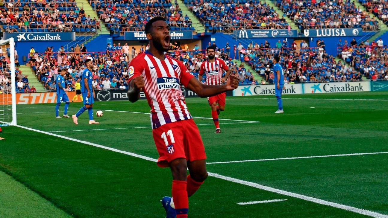 Thomas Lemar celebrates after scoring his first goal for Atletico Madrid in a win against Getafe.