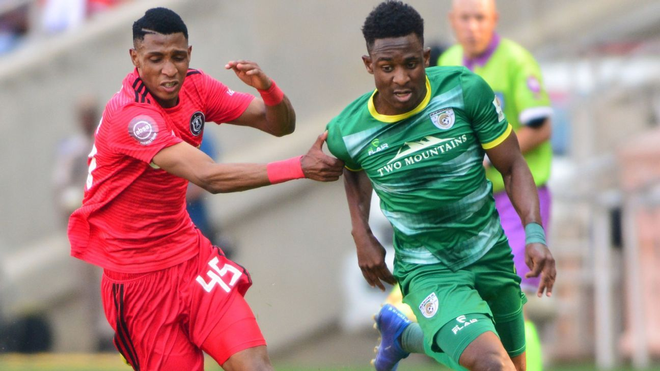 Vincent Pule of Orlando Pirates tussles with Talent Chawapihwa of Baroka FC