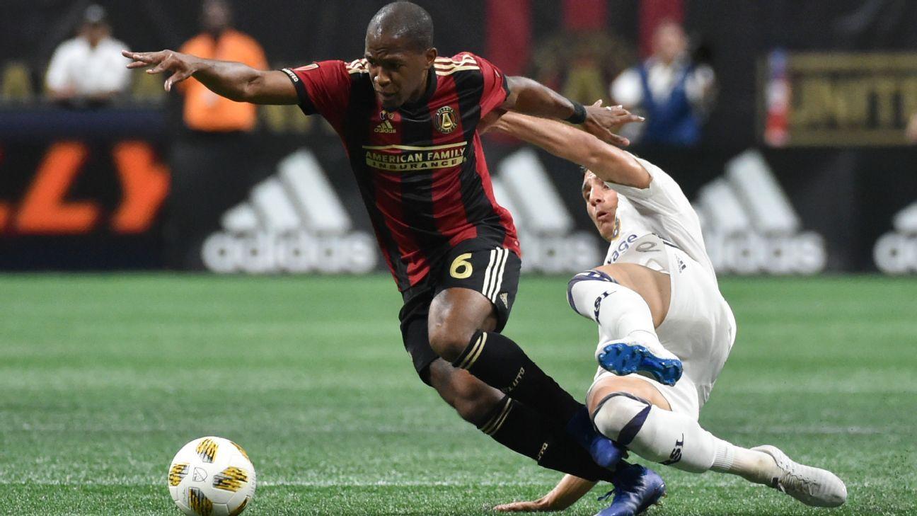 Atlanta United's Darlington Nagbe, left, is tripped up by Real Salt Lake midfielder Damir Kreilach.