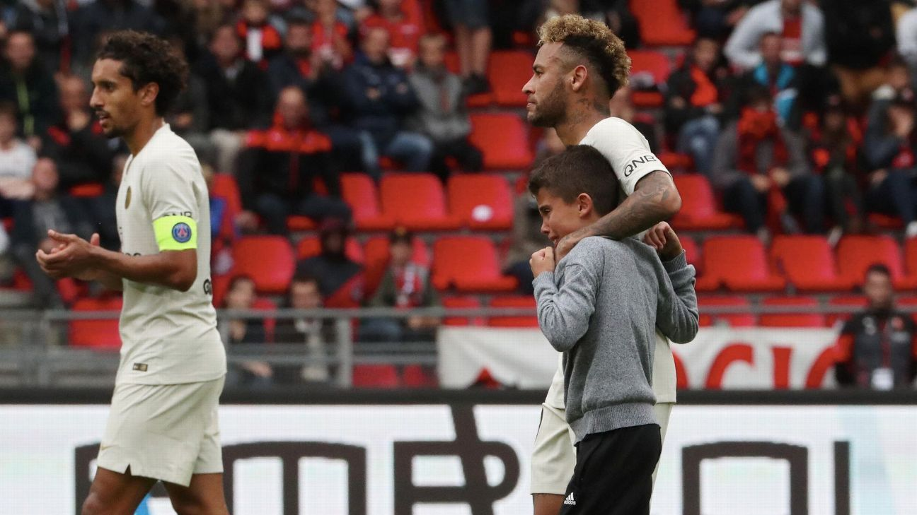 Neymar comforts a fan as he is substituted off PSG's game against Stade Rennes, giving the young pitch invader his shirt.