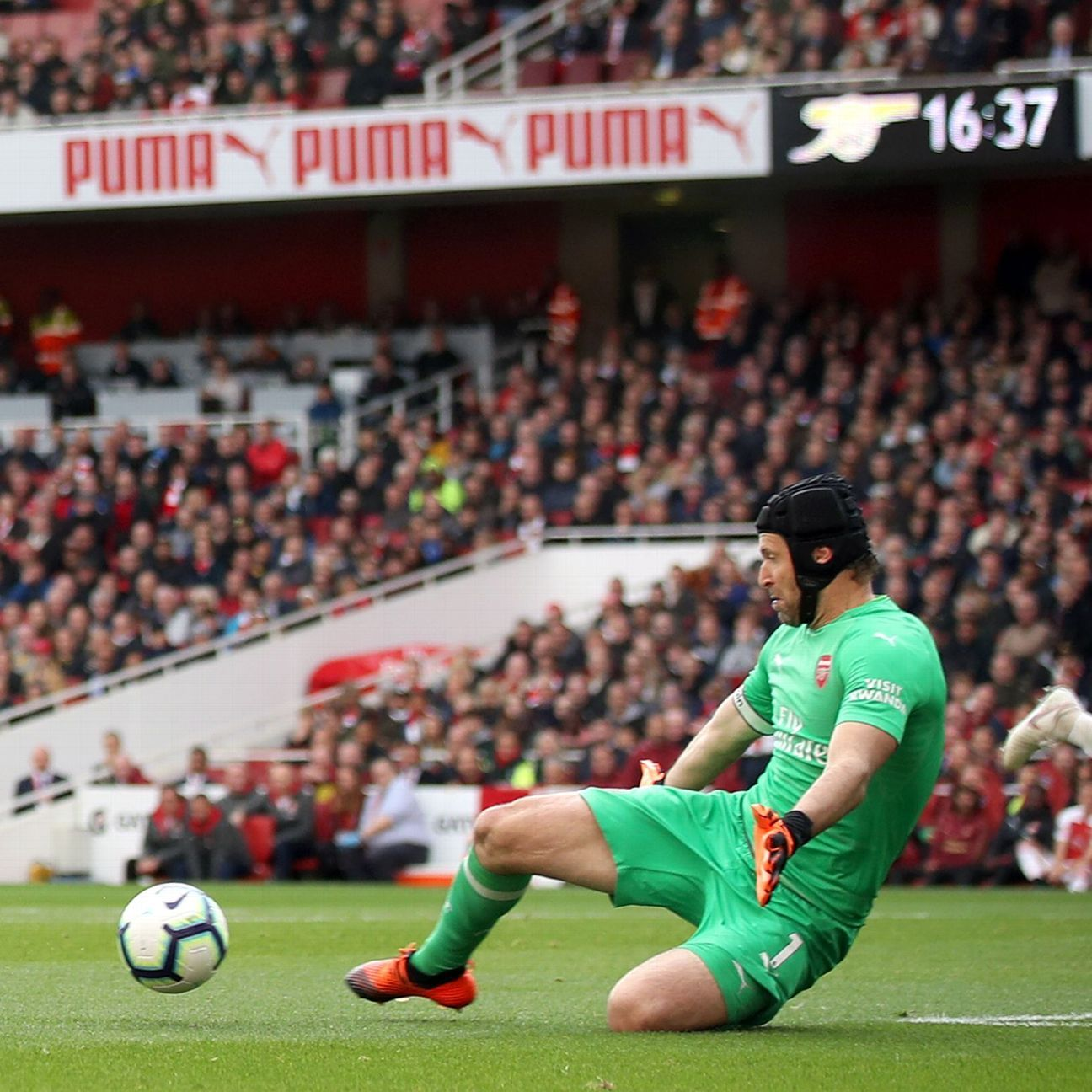 Petr Cech saves from Everton's former Arsenal forward Theo Walcott.