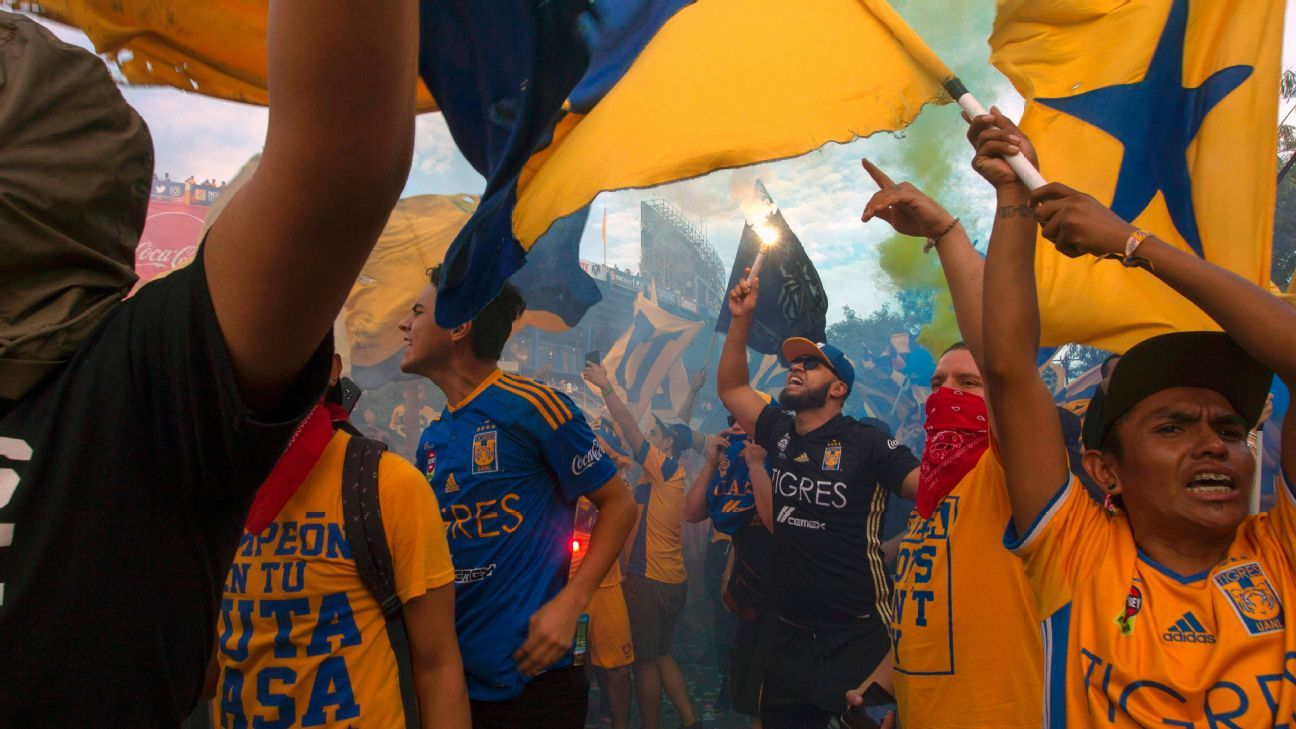 Tigres fans rally before Sunday's game outside the Estadio Universitario.