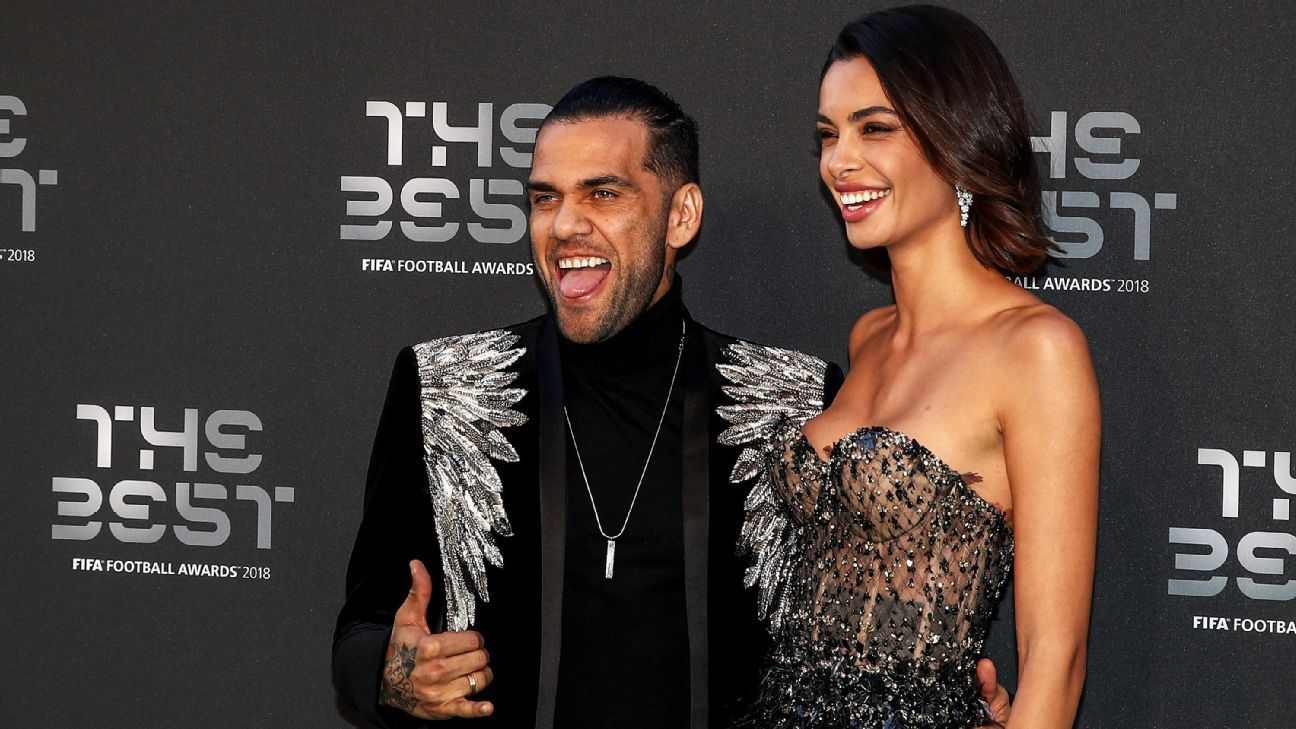 LONDON, ENGLAND - SEPTEMBER 24:  Dani Alves of Paris Saint-Germain (L) and Joana Sanz arrive on the Green Carpet ahead of The Best FIFA Football Awards at Royal Festival Hall on September 24, 2018 in London, England.