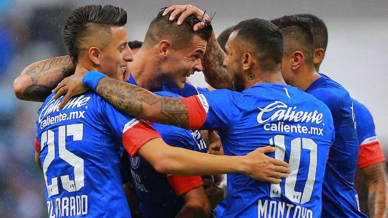 Cruz Azul players celebrate during their Liga MX win over Atlas.
