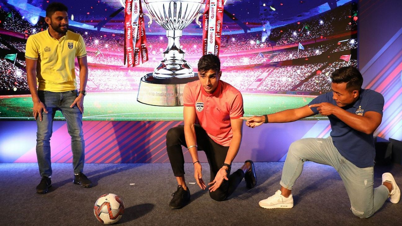 Jeje Lalpekhlua, right, of Chennaiyin FC shows his signature move as Bengaluru FC keeper Gurpreet Singh Sandhu, centre, and Kerala Blasters' Anas Edathodika looks on during the Hero ISL 2018-19 Media Day in Bengaluru.
