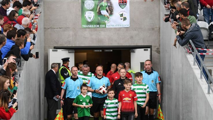 Led by members of Liam Miller's family, ex-Man United, Celtic and Ireland players take the pitch in Cork.