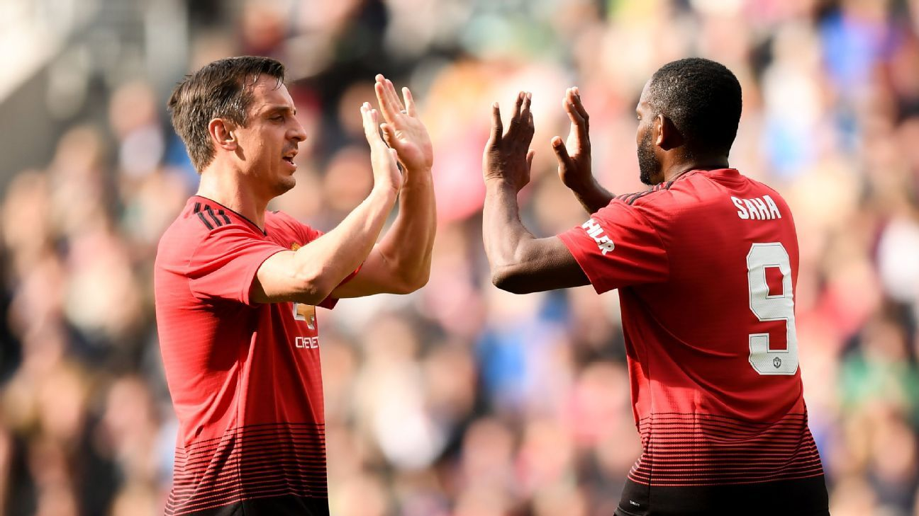 Gary Neville and Louis Saha celebrate the Frenchman's first-half goal against the Ireland & Celtic legends.