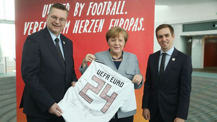 Germany's Euro 2024 bid led by Reinhard Grindel, left, started off as a foregone conclusion but feels far from certain ahead of Thursday's vote.