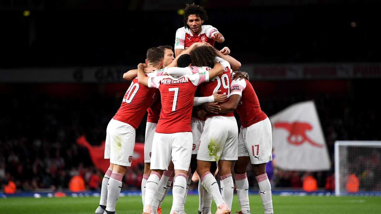 Arsenal players celebrate during their Carabao Cup match against Brentford.