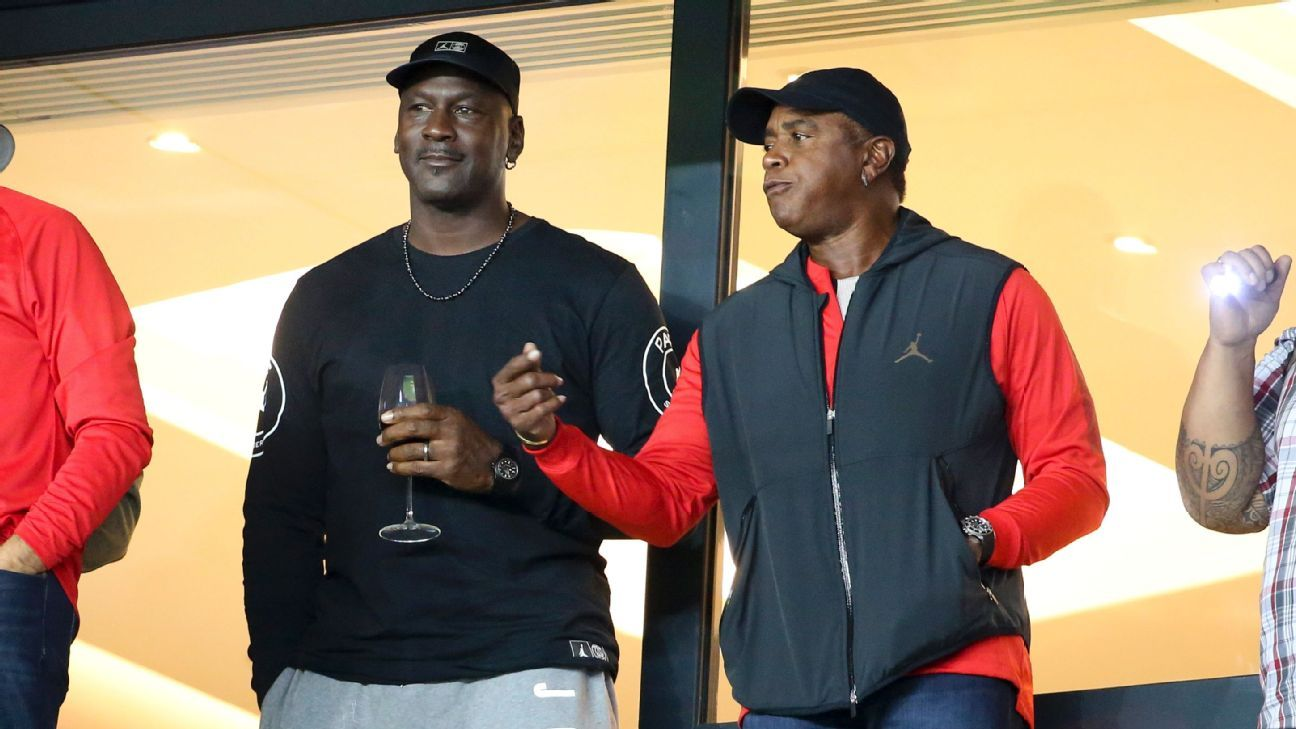 Michael Jordan and Ahmad Rashad take in PSG-Reims from Parc des Price in Paris.