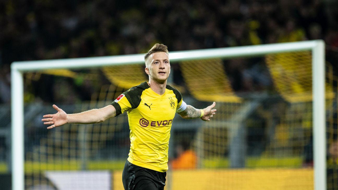 Marco Reus celebrates during Borussia Dortmund's Bundesliga win over Nurnberg.