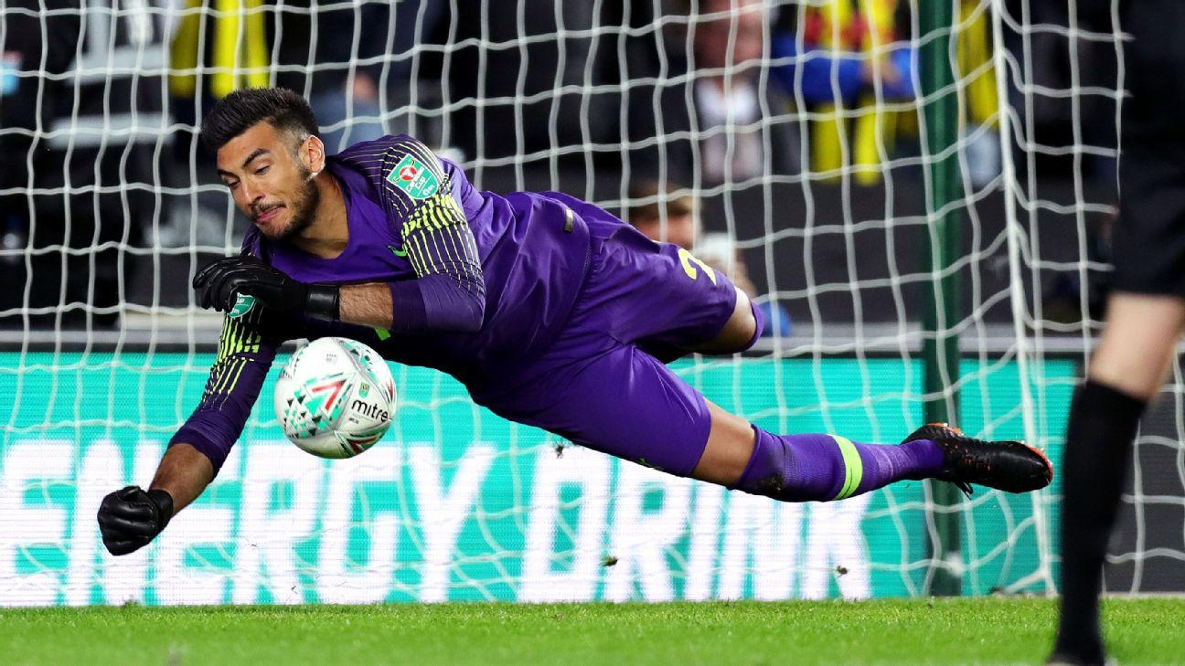 Paulo Gazzaniga makes a save during Tottenham's penalty shootout win over Watford in the Carabao Cup.