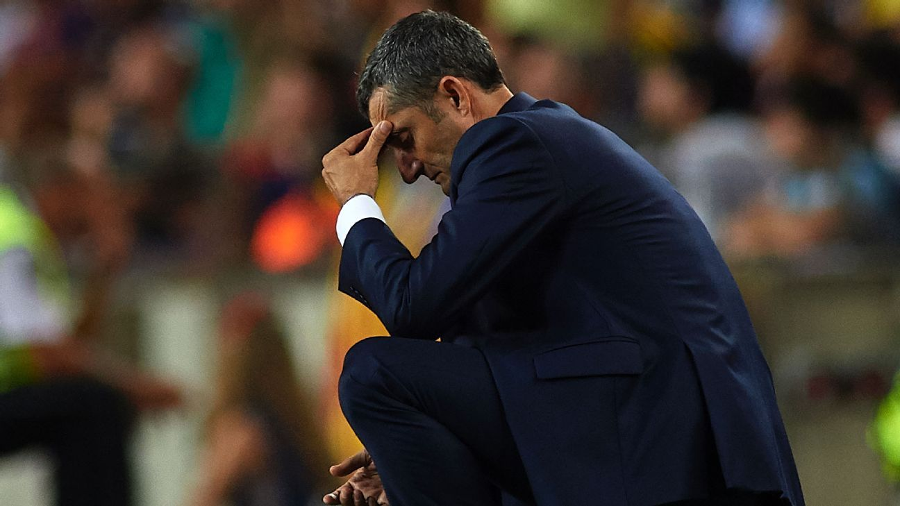 Barcelona boss Ernesto Valverde on his haunches during the La Liga defeat against Girona.