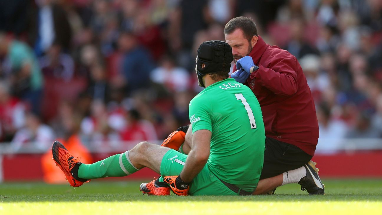 Petr Cech receives treatment prior to being substituted for an injury.