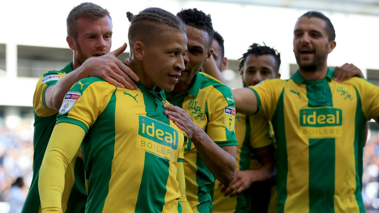 West Bromwich Albion's Dwight Gayle celebrates with his teammates after he scores his side's third goal.