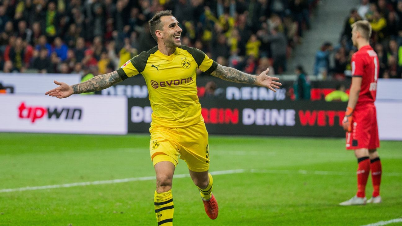 Paco Alcacer celebrates after scoring in Borussia Dortmund's Bundesliga win over Bayer Leverkusen.