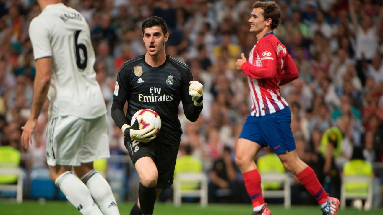 Thibaut Courtois makes a save in Real Madrid's La Liga draw against Atletico Madrid.