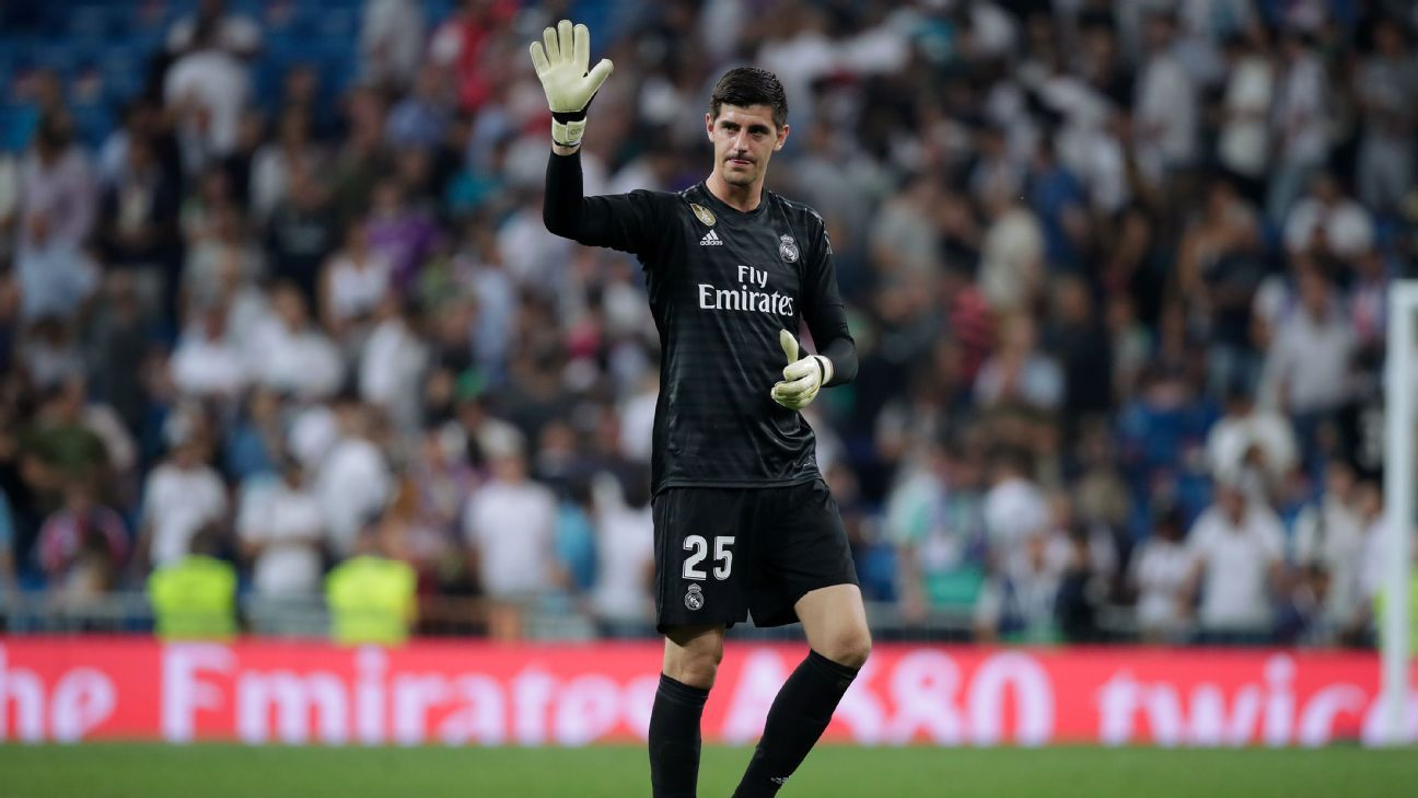 Thibaut Courtois applauds supporters after Real Madrid's La Liga draw with Atletico Madrid.