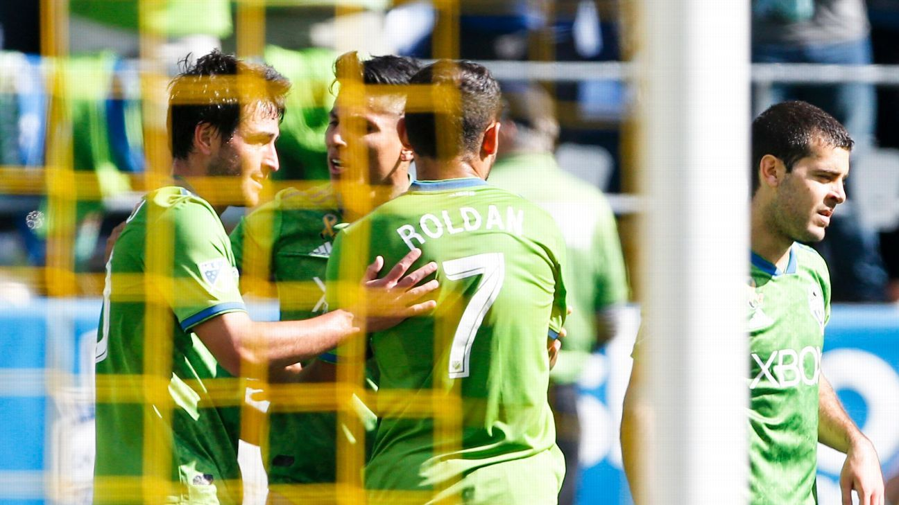 Seattle Sounders players celebrate after a Raul Ruidiaz goal against the Colorado Rapids.