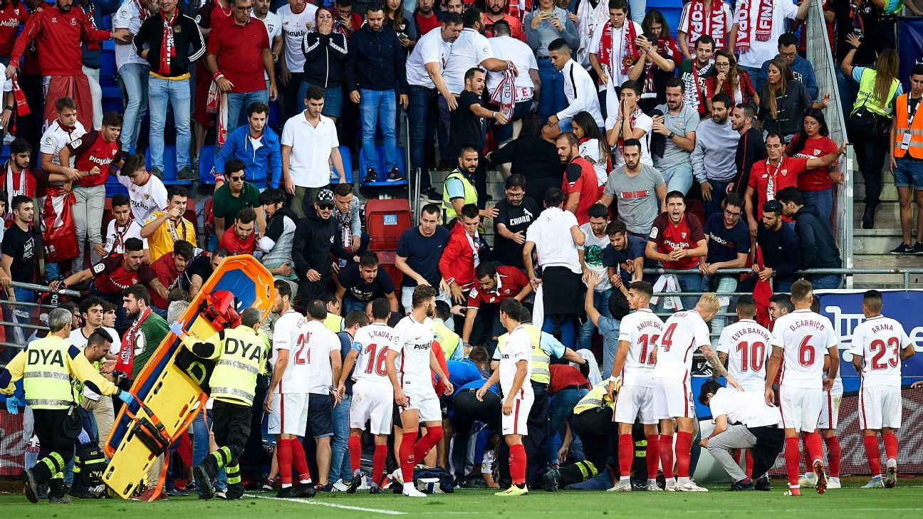 An injured Sevilla FC fan is seen to by medics after a barrier collapsed during their match against Eibar.