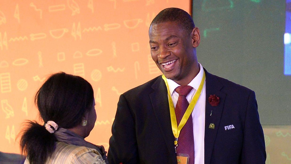 FIFA Secretary General Fatma Samoura (L) congratulates Walter Nyamilandu on his election