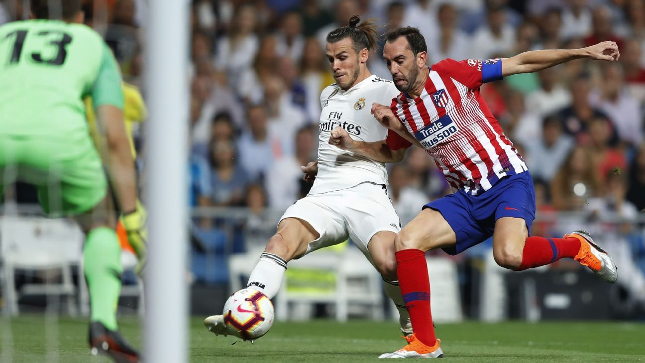 Godin, right, looks a step off the pace this season but fortunately, his errors didn't give Real a victory in Saturday's Madrid derby.