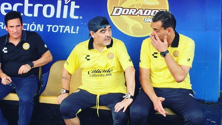 Diego Maradona, centre, has been trying to limit the strain of the job on his knees but can't resist celebrating goals by springing to his feet.