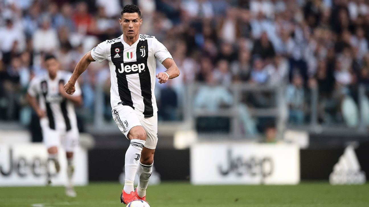 Cristiano Ronaldo dribbles the ball in Juventus' Serie A win over Napoli.
