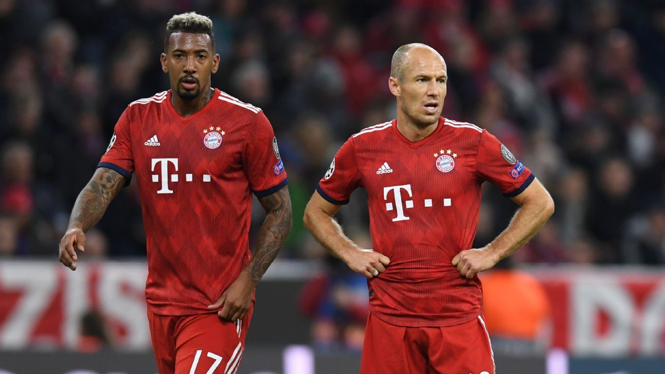 Jerome Boateng, left, and Arjen Robben look on after Bayern Munich conceded vs. Ajax.