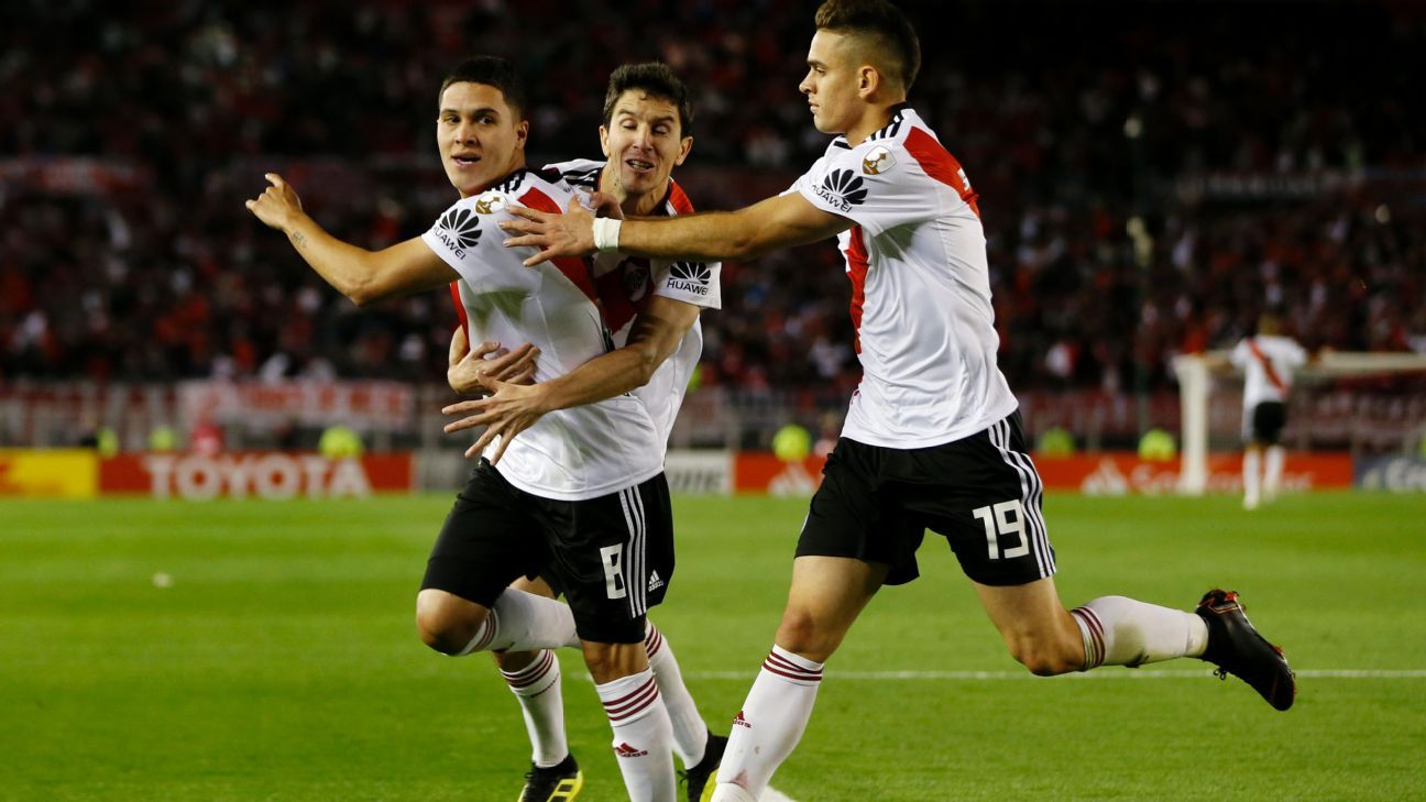 Teammates celebrated Juan Fernando Quintero (left) after his goal gave River Plate the lead for good.