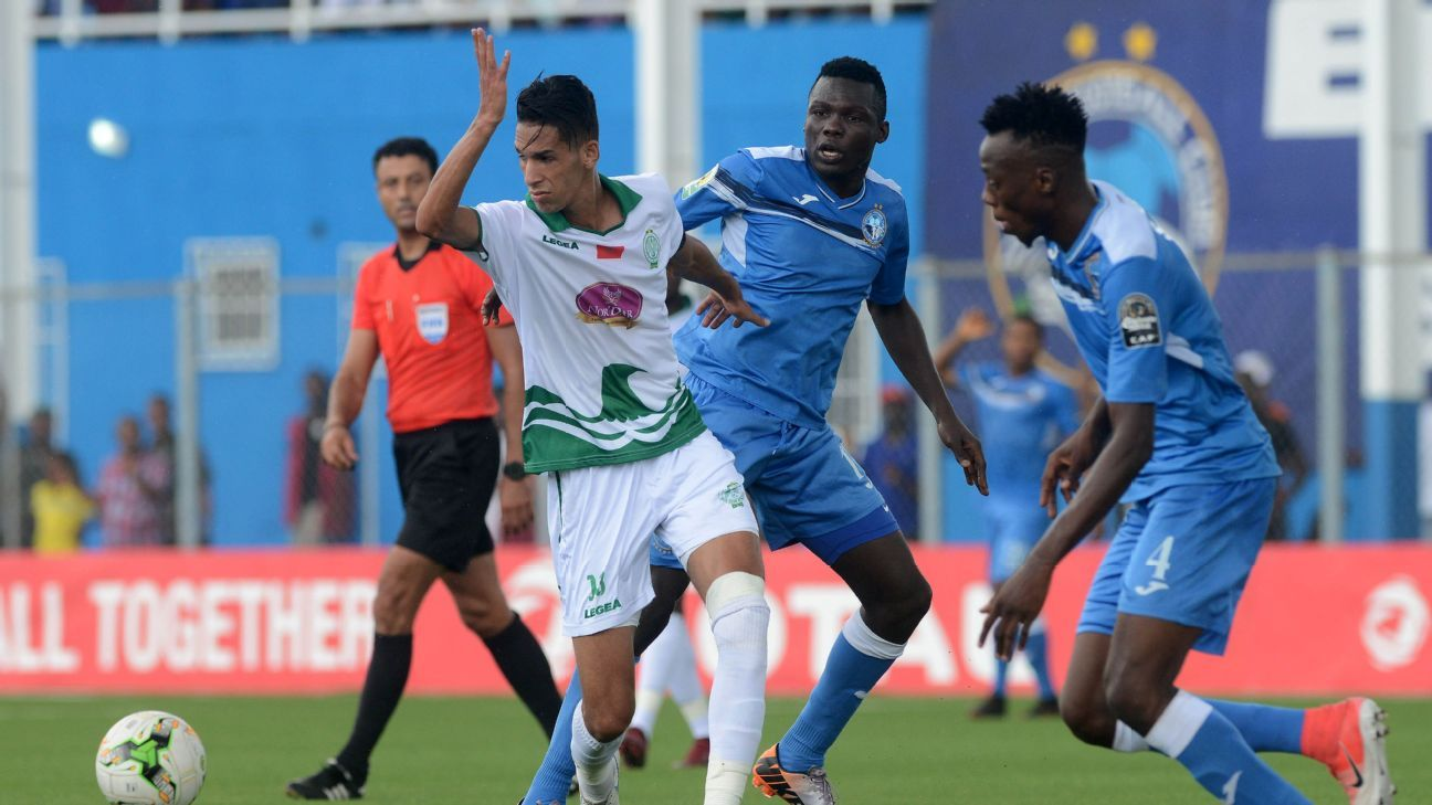 Badr Benoun of Raja Casablanca takes on Ibrahim Mustapha and Sunday Adetunji of Enyimba