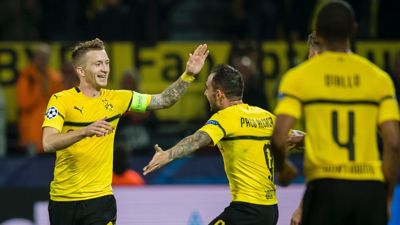 Marco Reus, left, celebrates with Dortmund teammate Paco Alcacer after scoring a goal against Monaco.