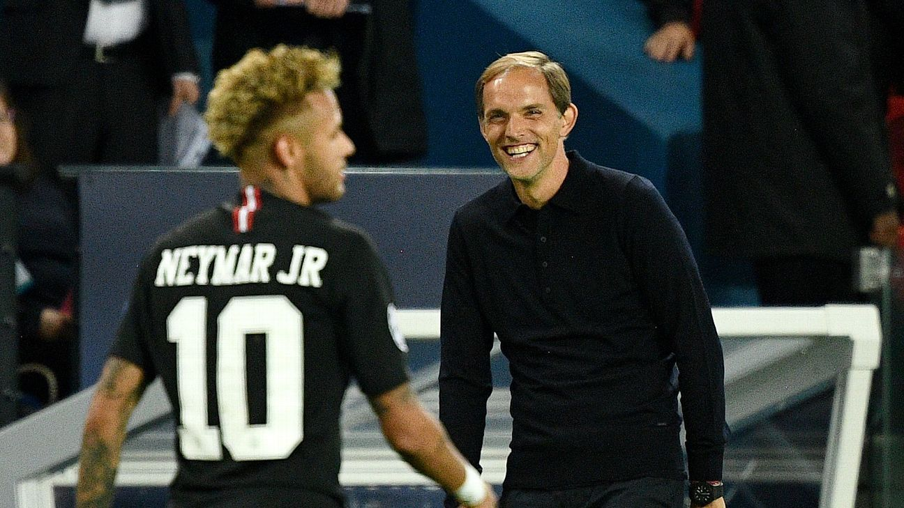 PSG coach Thomas Tuchel smiles as Neymar walks off the pitch.