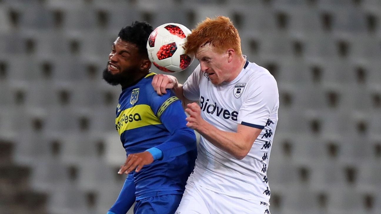 Simon Murray of Bidvest Wits battles for the ball with Keanu Cupido of Cape Town City FC
