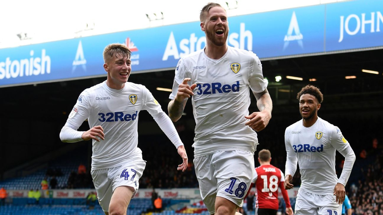 Pontus Jansson of Leeds United celebrates with Jack Clarke and Tyler Roberts.