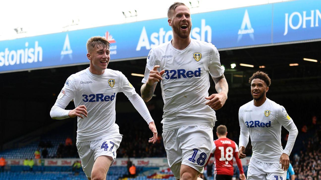 Pontus Jansson of Leeds United celebrates with Jack Clarke and Tyler Roberts.