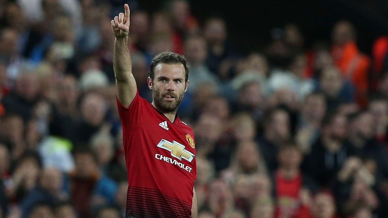Juan Mata of Manchester United celebrates scoring.