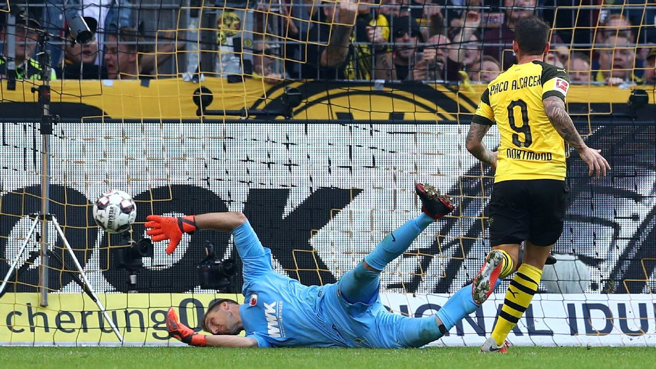 Paco Alcacer of Borussia Dortmund scores the first goal of his hat trick in a win against Augsburg.