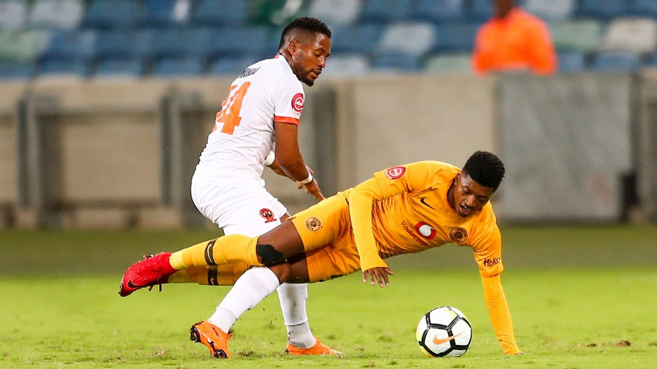 Dumisani Zuma of Kaizer Chiefs is challenged by Vusimusi Mngomezulu of Polokwane City