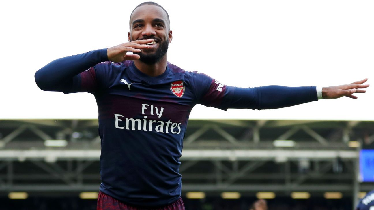 Alexandre Lacazette of Arsenal celebrates after scoring his team's second goal at Fulham.
