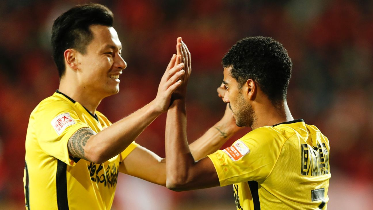 Guangzhou Evergrande's Alan, right, celebrates with Gao Lin