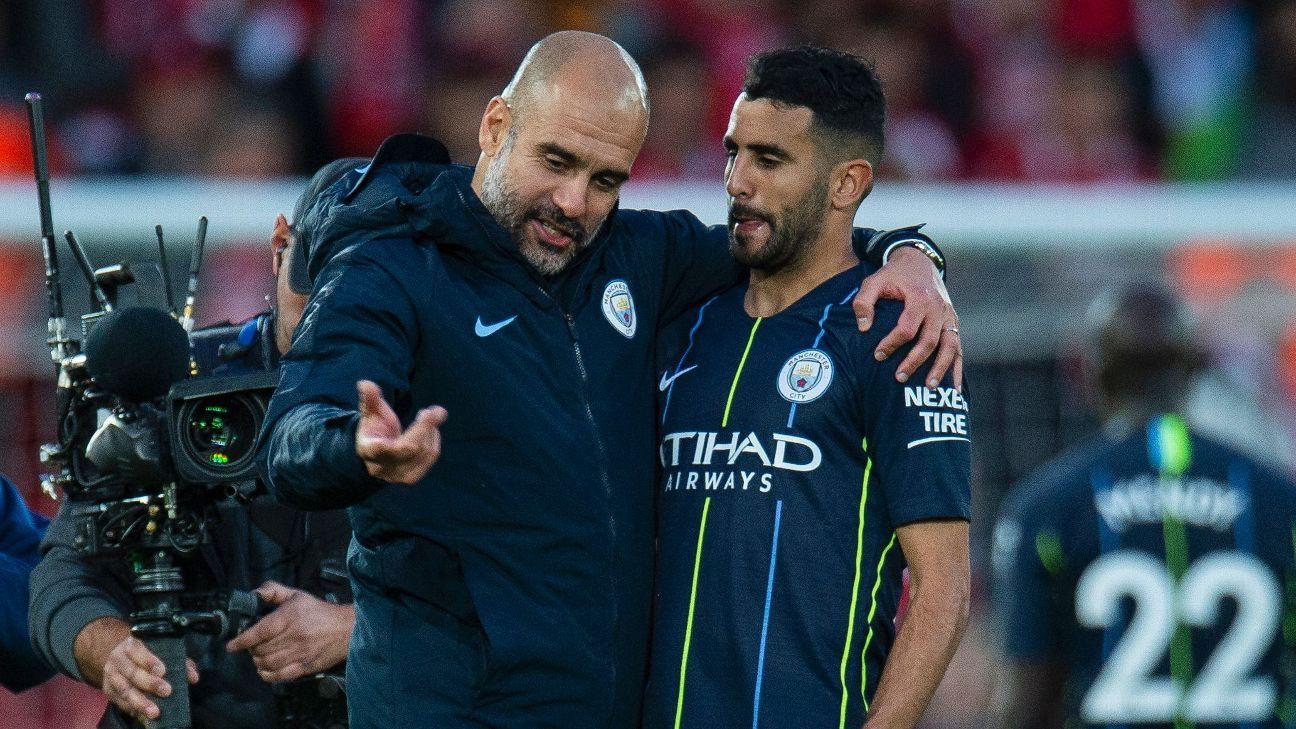 Pep Guardiola consoles Riyad Mahrez after Sunday's draw at Liverpool.