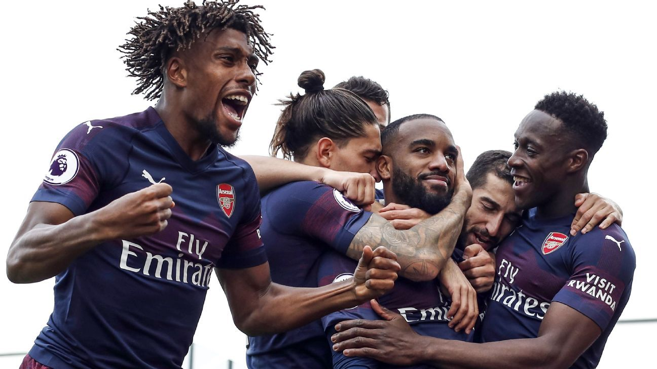 Alexandre Lacazette celebrates with teammates after scoring Arsenal's second goal at Fulham.