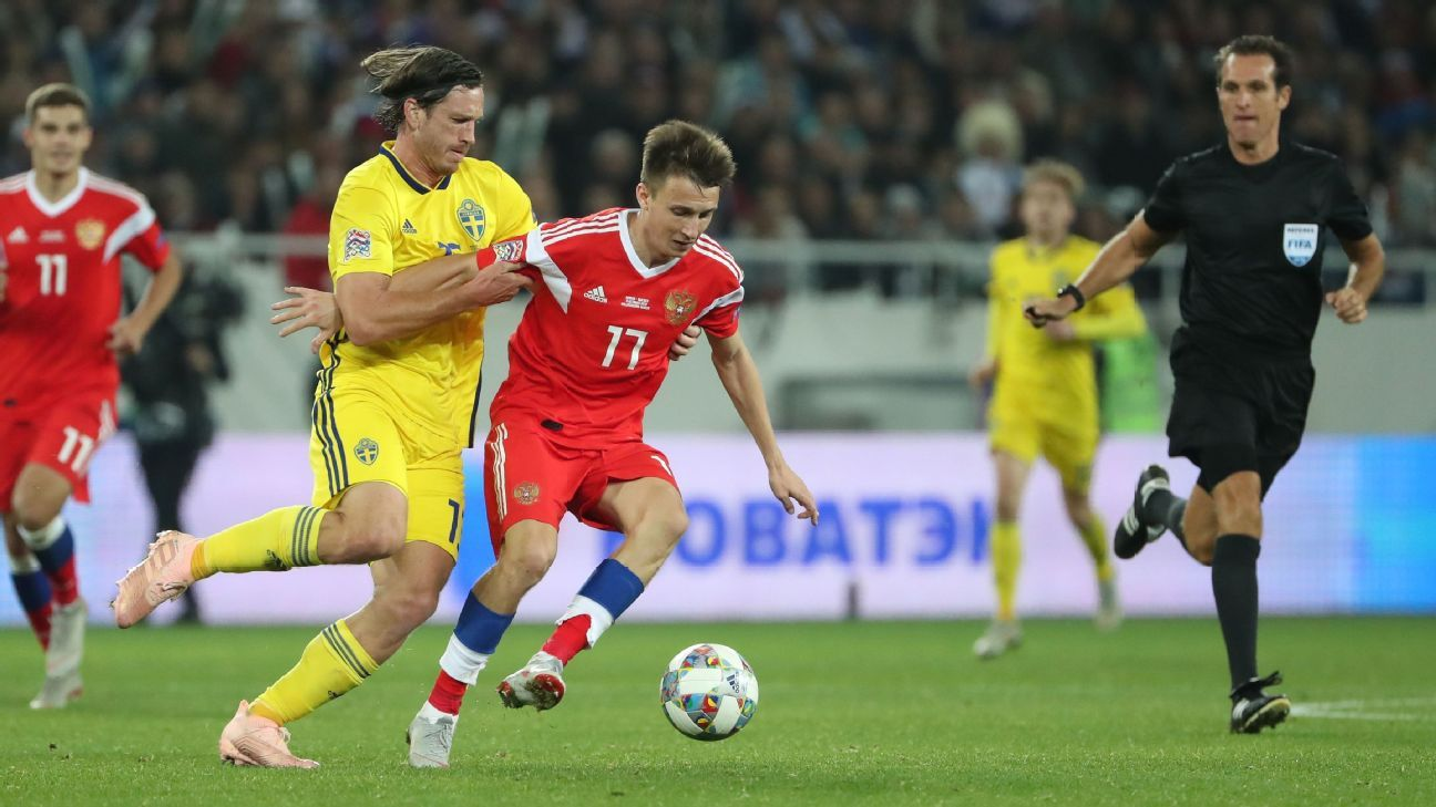 Gustav Svensson of Sweden, left, in action against Roman Zobnin of Russia in a UEFA Nations League match.