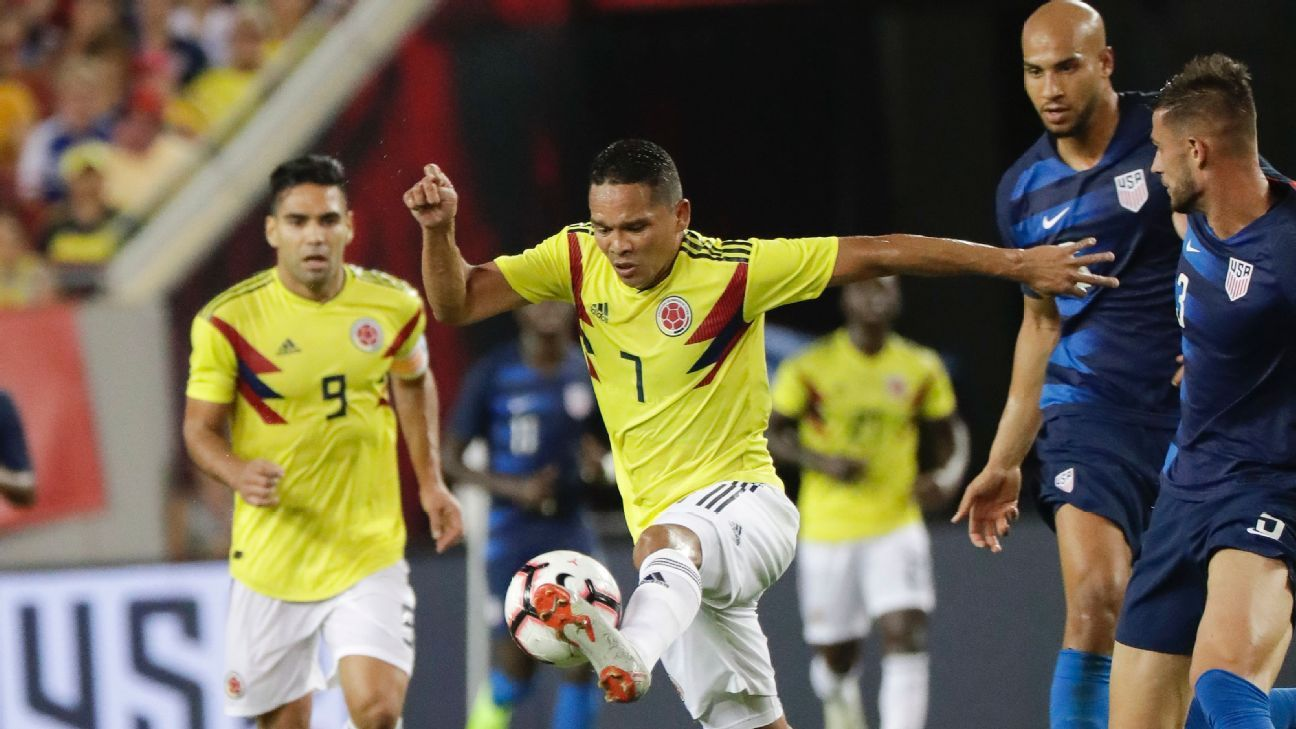Colombia's Carlos Bacca leaves U.S. defenders Matt Miazga, far right, and John Brooks behind.