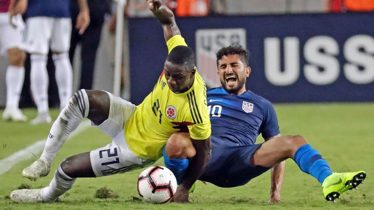 United States' Kenny Saief falls under a challenge.