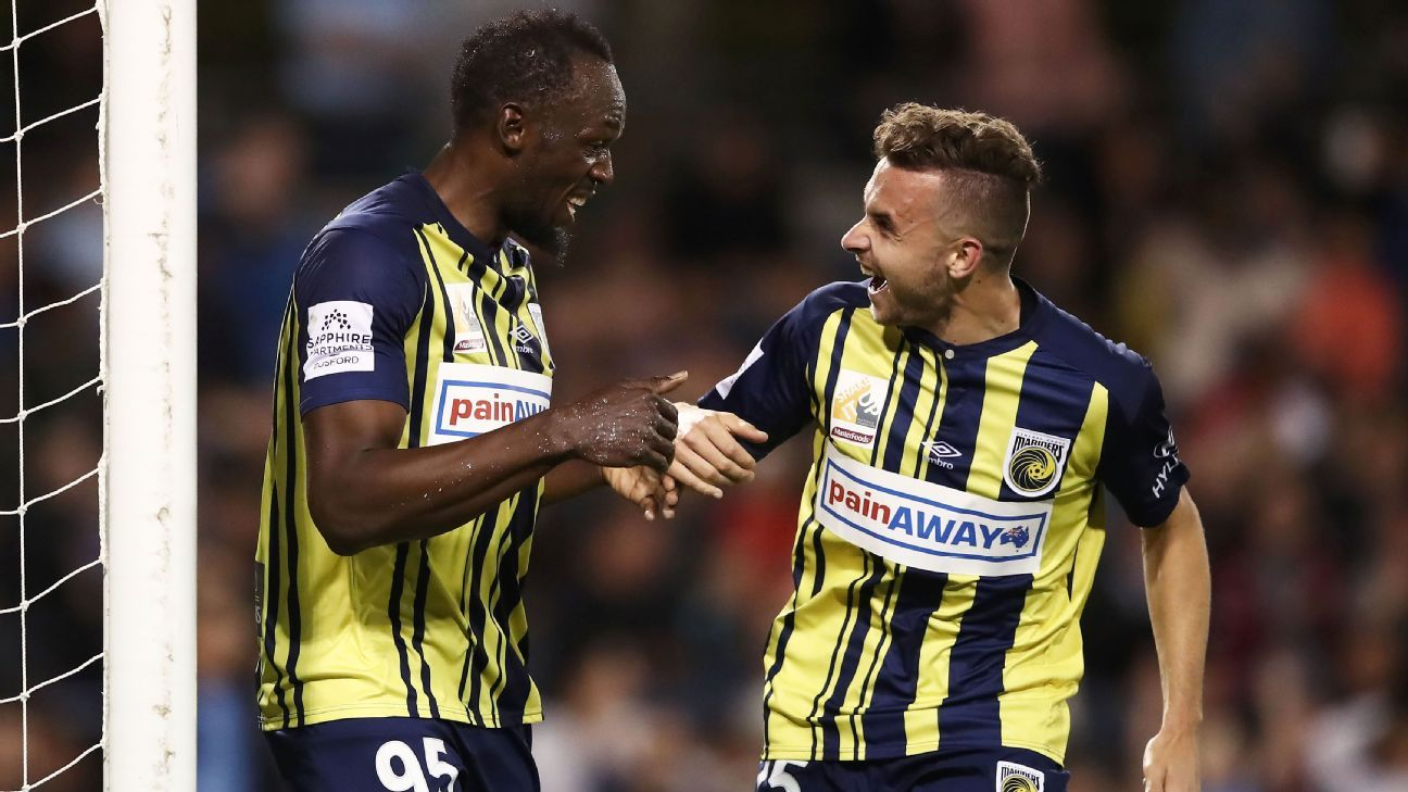 Usain Bolt of the Mariners (L) celebrates with Jordan Murray (R) after scoring his second goal.
