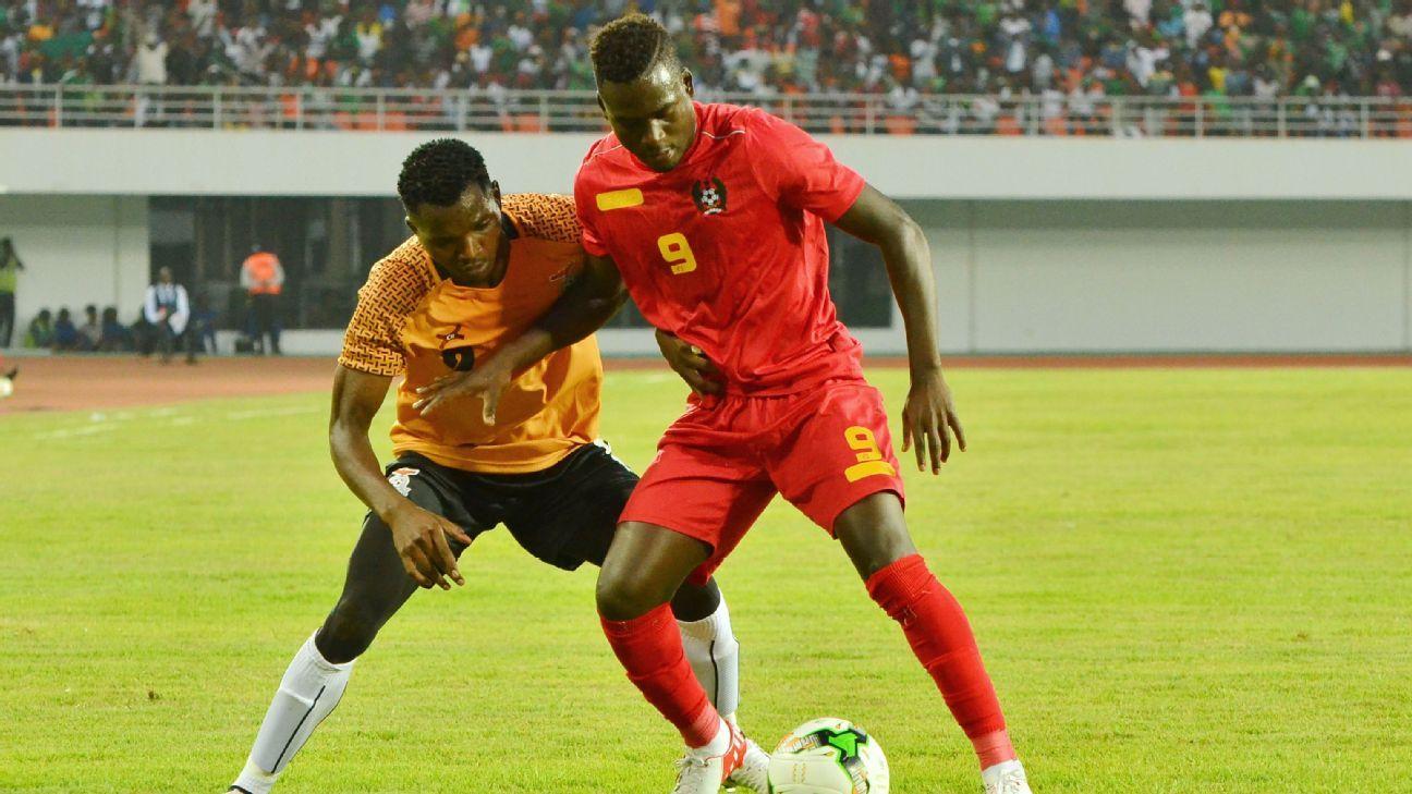 Solomon Sakala of Zambia tackles Carlos Eiubaloof of Guinea-Bissau