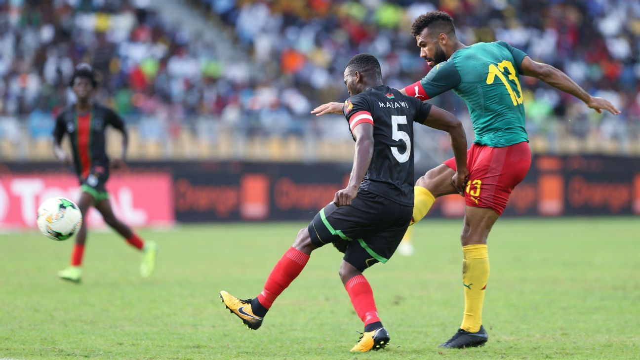 Eric Maxim Choupo-Moting of Cameroon shoots past John Lanjesi of Malawi