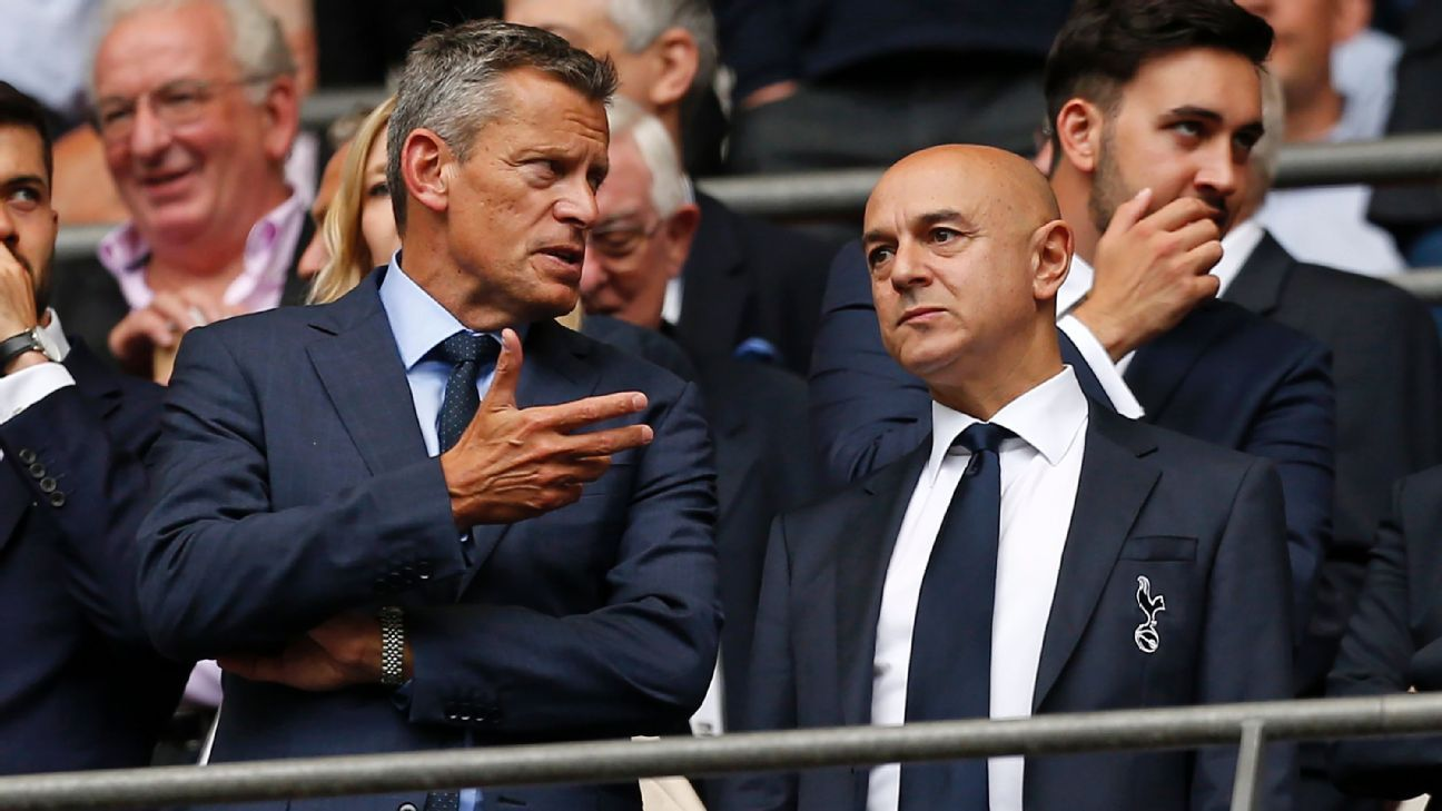 FA chief executive officer Martin Glenn, left, speaks with Tottenham's chairman Daniel Levy at Wembley Stadium.